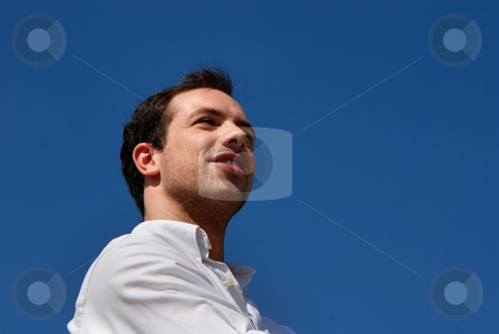 Enjoy stock photo, Young casual man portrait with the sky as background by Rui Vale de Sousa
