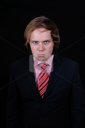 Mad stock photo, Young mad man portrait on black background by Rui Vale de Sousa
