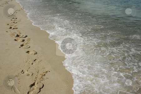 Footprints stock photo, Footprints in the sand at the beach by Rui Vale de Sousa