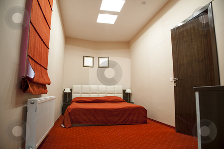 Hotel room stock photo, Hotel room with red and beige four stars empty by Adrian Costea
