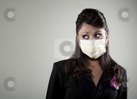 Woman wearing a breathing mask stock photo, Pretty young woman wearing a breathing mask for protection from germs and viruses by Scott Griessel