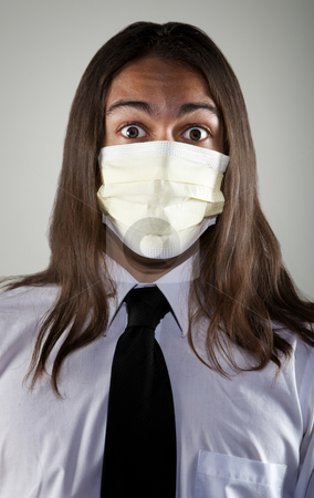 Man wearing a breathing mask stock photo, Handsome young man with long hair wearing a breathing mask for protection from germs and viruses by Scott Griessel