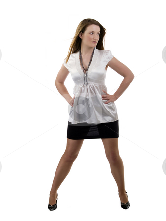 Full length woman in black skirt and white blouse stock photo, Young caucasian woman standing in black skirt and white blouse by Jeff Cleveland
