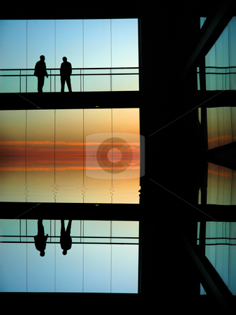 Sillouettes stock photo, People silhouettes in a modern builing at sunset by Rui Vale de Sousa