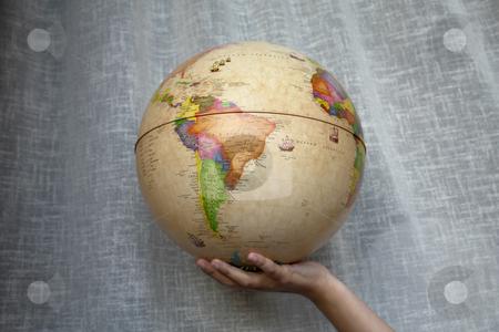 Globe stock photo, World globe in a woman hand detail by Rui Vale de Sousa