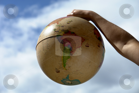 Globe stock photo, World globe in woman hand and the sky by Rui Vale de Sousa