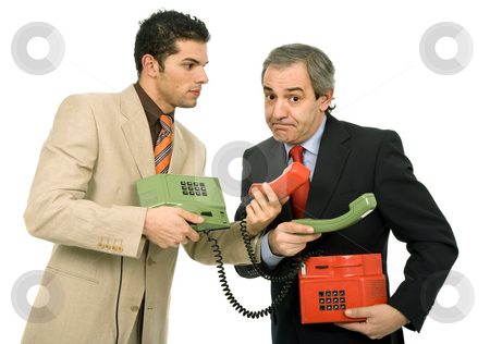 Working stock photo, Two young business men working with two telephones by Rui Vale de Sousa