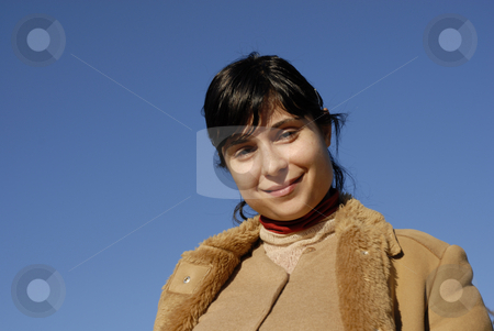 Woman stock photo, Young woman close up portrait and the blue sky by Rui Vale de Sousa