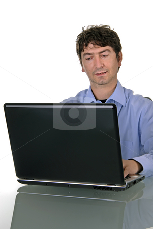 Working stock photo, Young man working with his personal computer by Rui Vale de Sousa