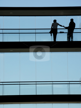 Holding stock photo, Couple holding hands in a modern building by Rui Vale de Sousa