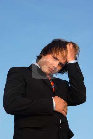 Headache stock photo, Young business man with sunset light in his face by Rui Vale de Sousa