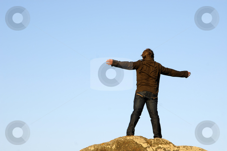 Wide open stock photo, Young man with arms wide open and the sky as background by Rui Vale de Sousa