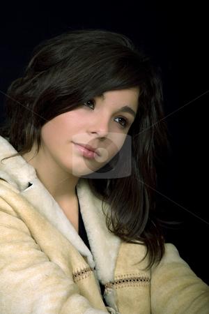 Sadness stock photo, Young beautiful brunette portrait against black background by Rui Vale de Sousa