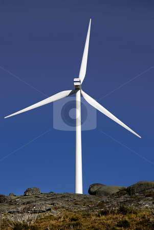 Windmill stock photo, White wind turbine in the top of the mountain by Rui Vale de Sousa