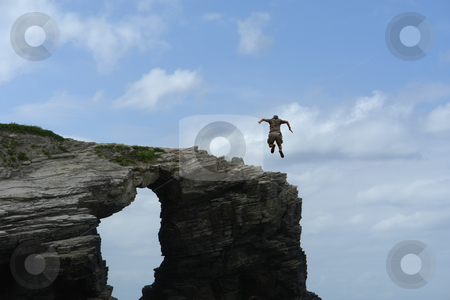 Jump stock photo, Male boy jumping from a big rock by Rui Vale de Sousa