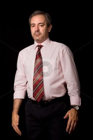 Businessman stock photo, Mature business man portrait on black background by Rui Vale de Sousa