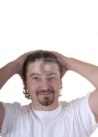 Man stock photo, Casual caucasian young man with his hands in the head by Rui Vale de Sousa