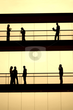Workers stock photo, Workers silhouette in sepia tone at a modern building by Rui Vale de Sousa