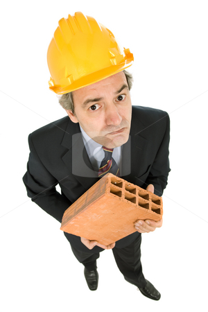 Worker stock photo, Mature worker holding a brick, isolated on white by Rui Vale de Sousa