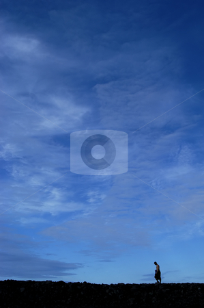Walking stock photo, Young man walking in the wall with the sky as background by Rui Vale de Sousa