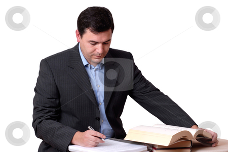 Read stock photo, Young business man reading a book on white by Rui Vale de Sousa