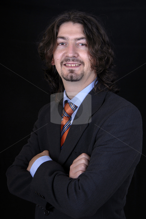 Man stock photo, Young business man portrait on black background by Rui Vale de Sousa