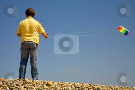 Fly stock photo, Young man at the beach playing with the wind by Rui Vale de Sousa
