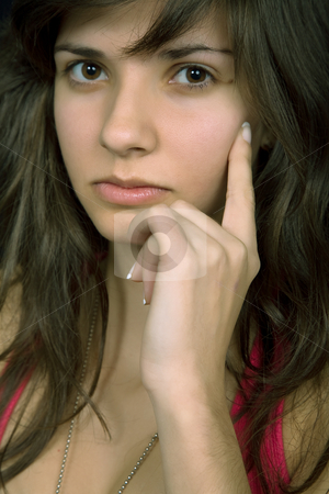 Pensive stock photo, Young beautiful brunette portrait against black background by Rui Vale de Sousa