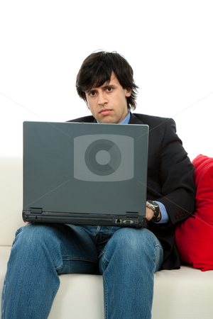 Working stock photo, Young man working with laptop in a couch by Rui Vale de Sousa