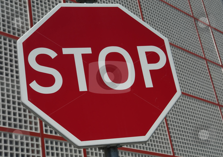 Stop stock photo, Red stop sign with a new building in the back by Rui Vale de Sousa