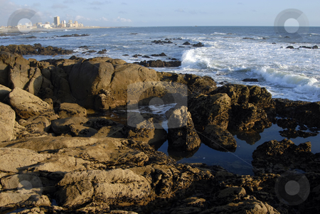 Coast stock photo, City at the coast in the south of portugal, focus in the rocks by Rui Vale de Sousa