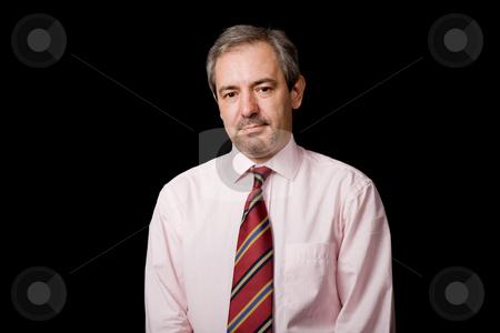 Portrait stock photo, Mature business man portrait on black background by Rui Vale de Sousa