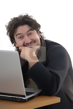 Working stock photo, Young man working with a personal computer by Rui Vale de Sousa