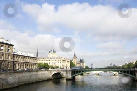 View over the Seine stock photo, A view over the River Seine, Paris, France, with the sun lighting up the Conciergerie on Ile de la Cit? by Corepics VOF