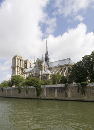 Notre Dame View stock photo, A classic, almost archetypal view of the Notre Dame and Ile de la Cit?, seen from across the river Seine in Paris. The cathedral is basking in the sunlight by Corepics VOF