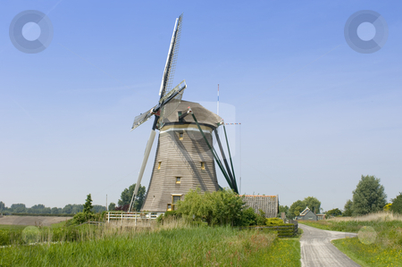Archetypal Dutch Windmill stock photo, An archetypal Dutch windmill in Leidschendam on a nice spring day. by Corepics VOF