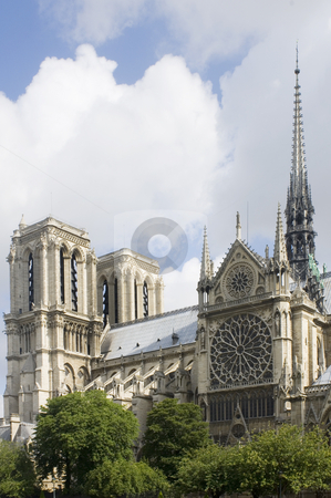 Notre Dame Detail stock photo, A detail of the Notre Dame, Paris, France with the sunlight striking the towers of this majestic cathedral and tourist attraction. The famous landmark is located on Ile de La Cit? by Corepics VOF