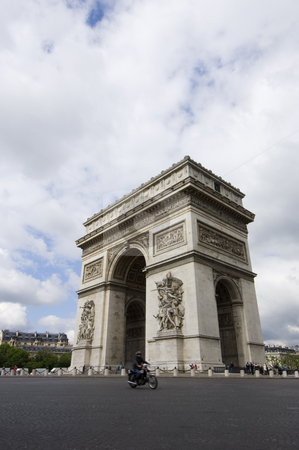 Arc de Triomphe stock photo, The World Famous Arc de Triomphe on the Champs ?lis?e in paris with a three point perspective and a motor cyclist in front in slight motion blur. by Corepics VOF