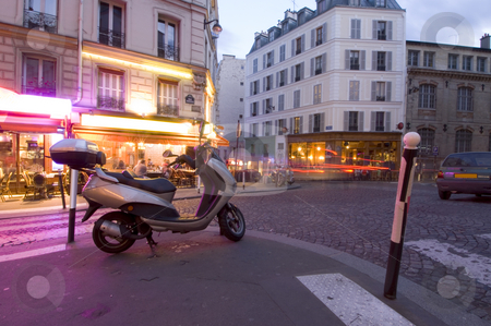 Paris night life stock photo, The streets of Paris are still full of activity, lit by neon advertisements, signs and billboards; people lingering on the terraces and cars rushing by. Nightlife in Montmartre by Corepics VOF