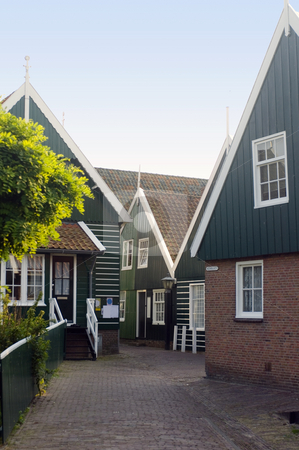 Marken Chapel stock photo, An obscure, typica chapel in the center of Marken, a peninsula in the IJsselmeer, the Netherlands, with it's characteristical wooden gables by Corepics VOF
