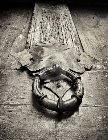 Entrance to the ancient history stock photo, Door knocker on an ancient door, closeup , black and white by Vladimir Koletic