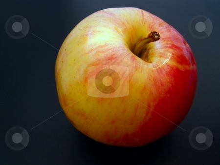 Red apple stock photo, Red juicy apple against the black background by Sergej Razvodovskij