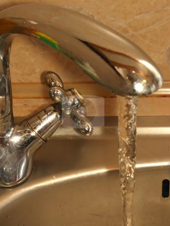 Water in the tap stock photo, Tap with run water in the kitchen by Sergej Razvodovskij