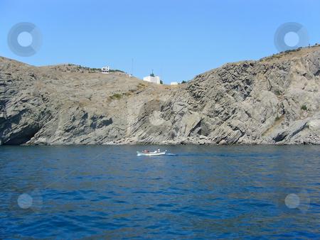 Sea and rock landscape stock photo, Summer sunny landscape with sea and rock by Sergej Razvodovskij