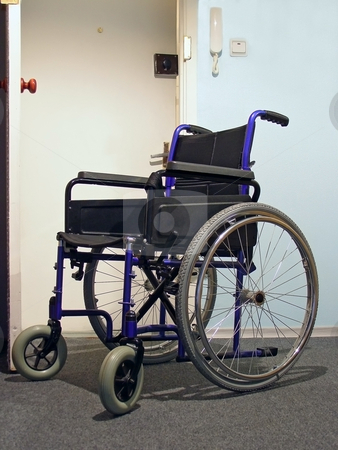Wheelchair in the hospital stock photo, Single wheelchair for patient in the hospital by Sergej Razvodovskij