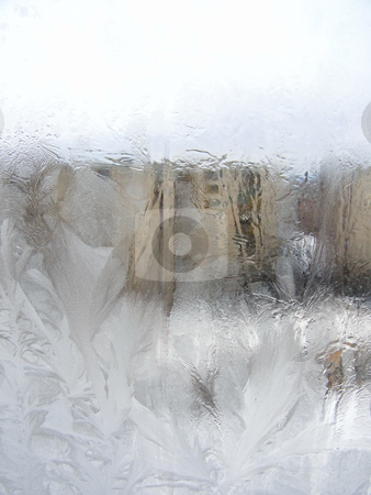 Frost town window stock photo, Winter frost window with the ornate crystals by Sergej Razvodovskij