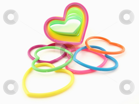 Hearts and Slinky stock photo, Assortment of colorful hearts and a slinky isolated on a white background by Robert Gebbie