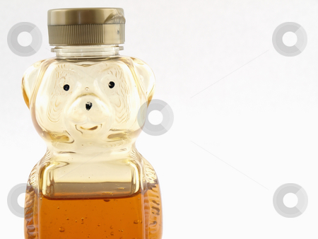 Half Full Honey Bear stock photo, A plastic bear shaped container half full of honey over a white background. Offset with room for text. by Robert Gebbie