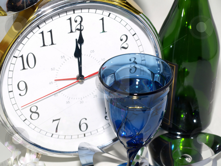 Happy New Year stock photo, A clock reading 12:01 with a glass and a green bottle. by Robert Gebbie