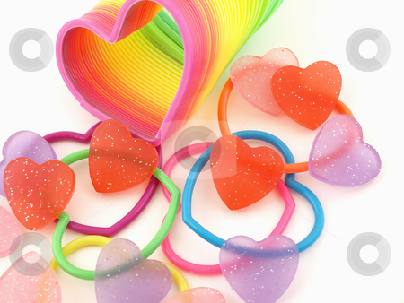 Many Different Hearts stock photo, Red Hearts scattered with colorful hearts and slinky isolated on a white background by Robert Gebbie